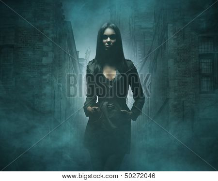 Young and sexy woman walking in the streets at night