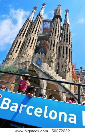 BARCELONA, SPAIN - AUGUST 18: Tourists at La Sagrada Familia on August 18, 2013 in Barcelona, Spain. The impressive cathedral designed by Antoni Gaudi is being built since 1882 and is not finished yet