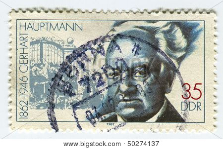 GERMANY - CIRCA 1987: A stamp printed in Germany  shows image of the Gerhart Hauptmann  was a German dramatist and novelist who received the Nobel Prize in Literature in 1912, circa 1987.