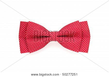 Red Bow Tie With White Polka Dots Isolated On White