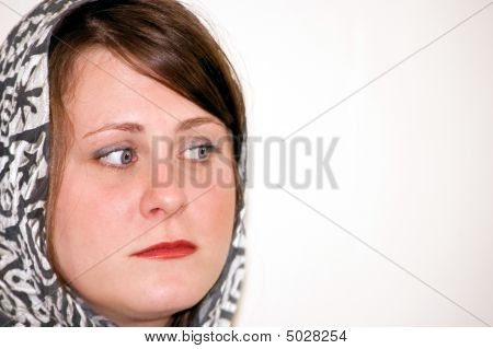 Young Woman Wearing Scarf Is Worried And Concerned