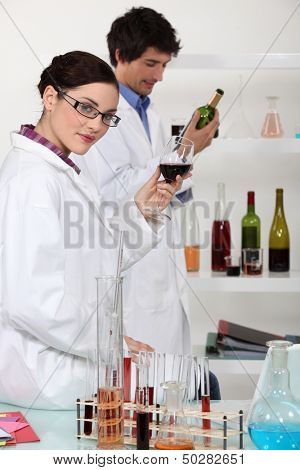 Oenologists analysing wine