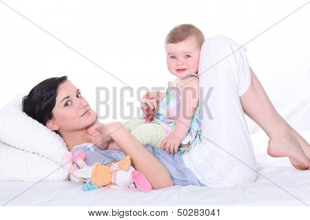Woman lying in bed with baby