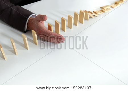 Hand of a man playing with dominoes
