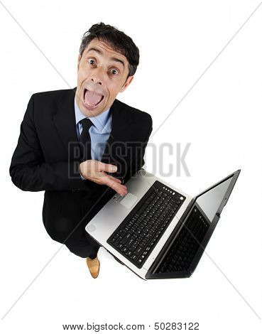 Persuasive garrulous businessman pointing to his computer with his hand as he explains and cajoles trying to win the argument, high angle humorous isolated on white