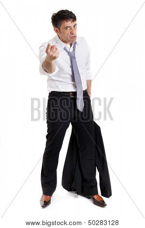 Belligerent businessman pointing a threatening finger at the camera in anger with a ferocious expression, full length isolated on white