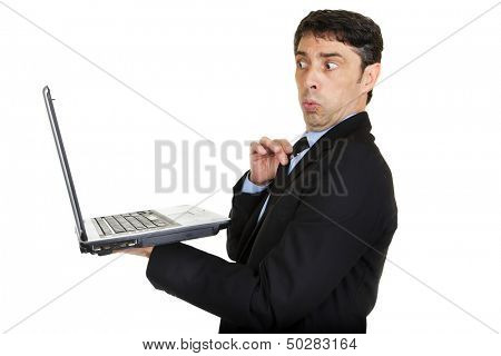 Man looking taken aback and affronted as he looks at the screen of his handheld laptop computer and sees something risque or offensive isolated on white