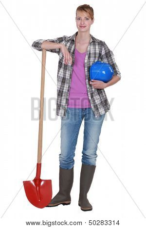 Potrait of a tradeswoman with her shovel