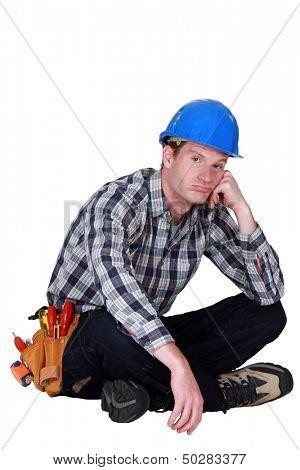 Bored builder sat on the floor