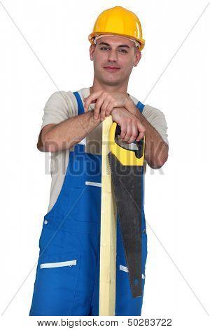 Craftsman holding a handsaw