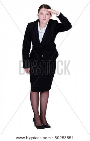 Businesswoman staring off into the horizon