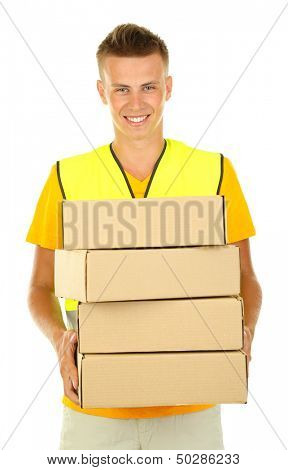 Young delivery man holding parcels, isolated on white