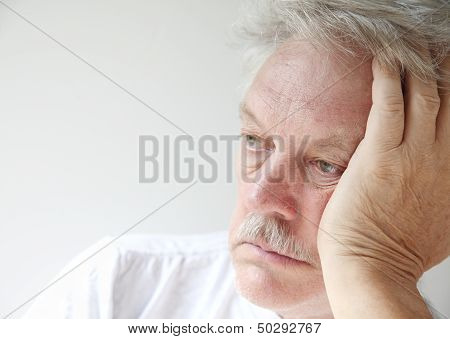 older man looking off into space