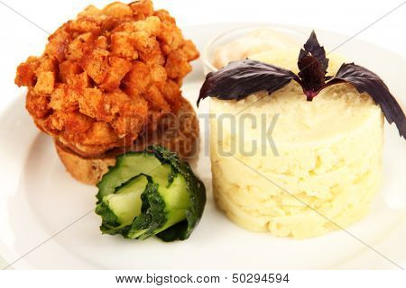 Chicken Kiev  and mashed potatoes on plate, isolated on white