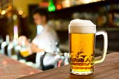stock photo of spigot  - a glass of beer in beer house - JPG