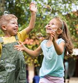 stock photo of fleet  - Children playing at the garden - JPG