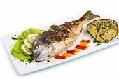 Grilled Gilt Head Sea Bream On Plate With Lemon ,salad And Grilled Vegetables