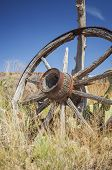 foto of wagon wheel  - Lone wagon wheel in a prairie Utah - JPG