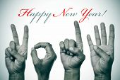 stock photo of seasons greetings  - sentence happy new year and hands forming number 2014 - JPG