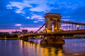 stock photo of hungarian  - Szechenyi Chain Bridge is a suspension that spans the River Danube between Buda and Pest - JPG