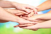 image of spirit  - United hands on bright background - JPG
