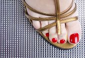stock photo of stomp  - Vintage close up foot on metal texture - JPG