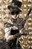 foto of top-gun  - Portrait of a beautiful steampunk woman holding a gun over vintage background - JPG