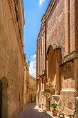 stock photo of carmelite  - Street in Mdina beside the Carmelite priory musem - JPG