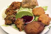 foto of samosa  - East Indian Food Appetizer Starter Dish with Samosa Pakoras Vegetable Cutlets with Chutney Tamarind Dipping Sauce Closeup