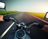 image of pov  - Driver riding motorcycle on an empty asphalt road - JPG