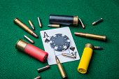 stock photo of ace spades  - Ace of Spades surrounded by bullets and a black poker chip.