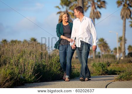 Young couple holding hands on a walk
