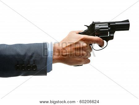 Male hand aiming revolver gun
