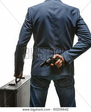 Hiding gun behind his back