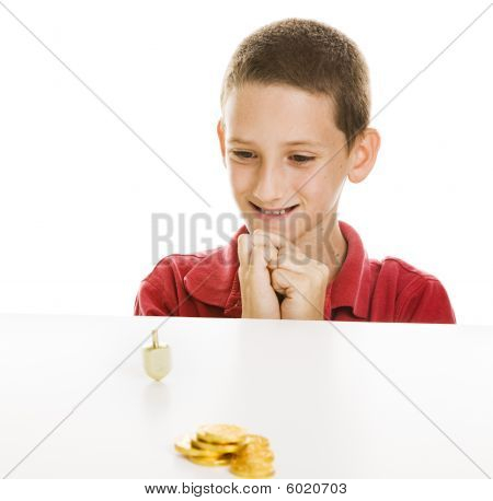 Boy Watching Dreidel Spin