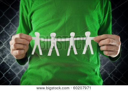 Man Holding Chain Of People Paper Cuts