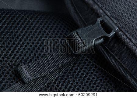 Black plastic buckle on backpack