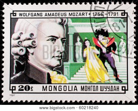 MONGOLIA - CIRCA 1981:A stamp printed by Mongolia, shows Composer Wolfgang Amadeus Mozart and Scene from his Magic Flute, circa 1981