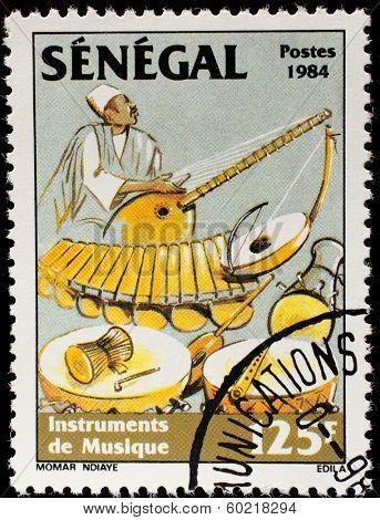 SENEGAL - CIRCA 1985: A stamp printed by Senegal, shows Musician playing balaphone, drums, circa 1985