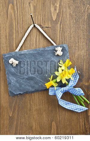 Little Slate Board And Fresh Daffodils