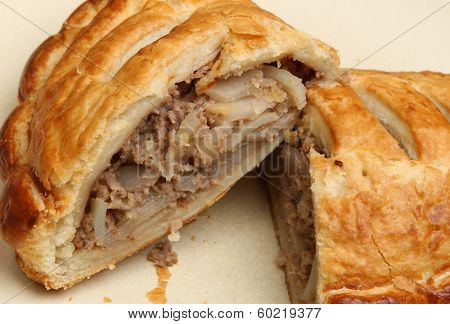 Cornish pasty showing meat and vegetable filling.