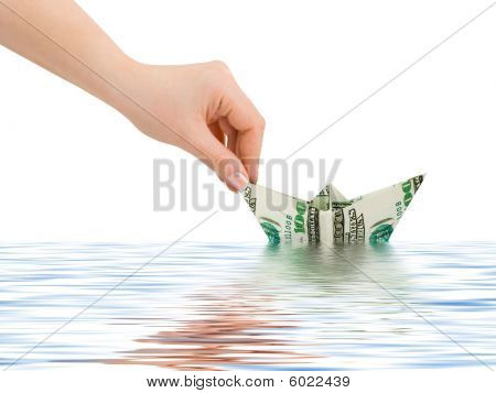 Hand Launching Money Ship