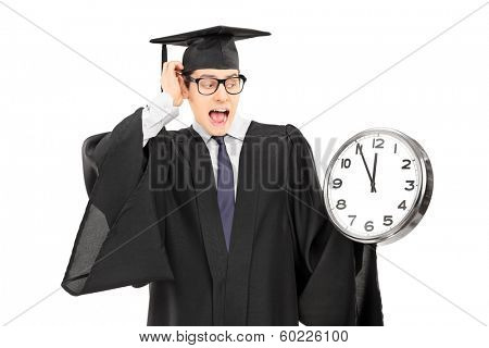 Surprised man looking at a big wall clock isolated on white background