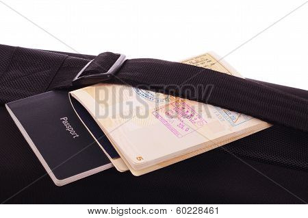 black travel bag and passports
