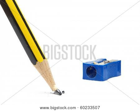 Black and yellow pencil with broken tip and blue sharpener shot on white background