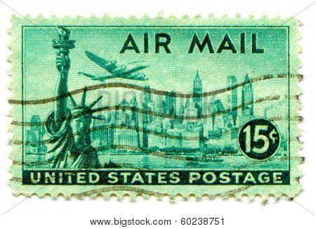 USA-CIRCA 1947: United States Airmail postage stamp showing image of  Lockheed Constellation airplane flying over New York city and Statue of Liberty, circa 1947.