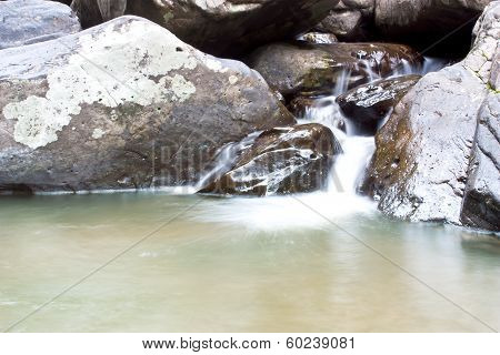 Waterfall Stream In The Mountains