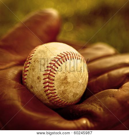 Vintage baseball glove and ball