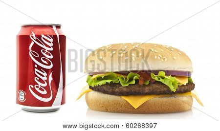 Coca-cola And Cheeseburger On A White Background
