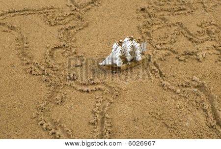 Ship On Sand Wit Global Map Outline